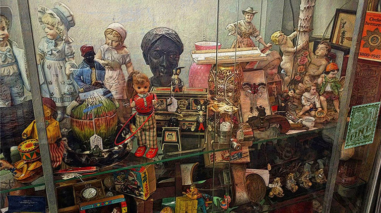 Collectables behind glass renningers by Greg Dampier - Illustrator & Graphic Artist of Lake Wales, Florida